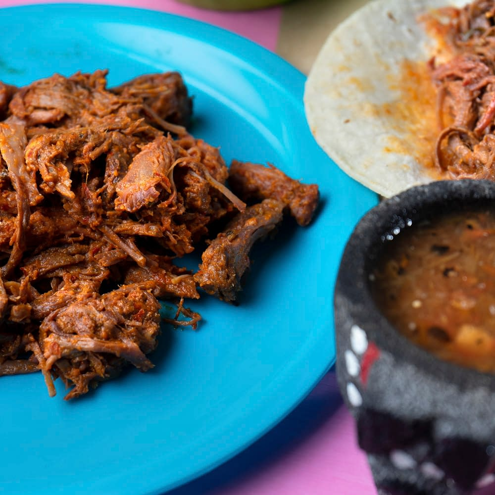 beef barbacoa on blue plate